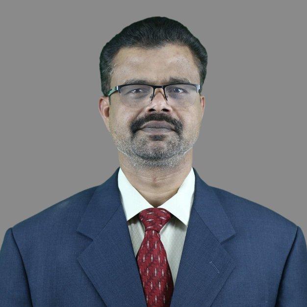 Dr Raja R